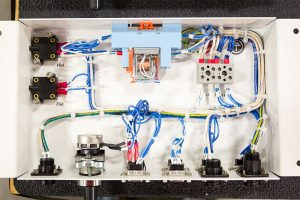 Components of an industrial electrical panel in a panel shop