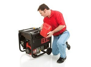 A man filling a backup generator with gasoline